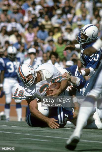MIAMI FL CIRCA 1970's Running back Larry Csonka of the Miami Dolphins in action is hit and brought down by linebacker Mike Curtis and defensive back...
