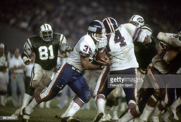 FLUSHING NY CIRCA 1970's Running back Larry Csonka of the New York Giants carries the ball against the New York Jets circa mid 1970's during an NFL...
