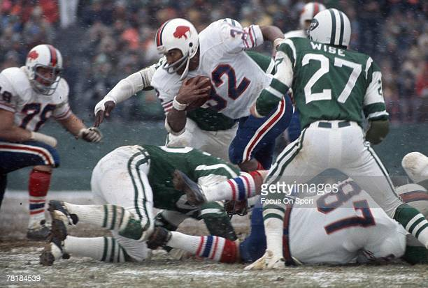 FLUSHING NY CIRCA 1970's Running back OJ Simpson of the Buffalo Bills carries the ball during a mid circa 1970's NFL game against the New York Jets...