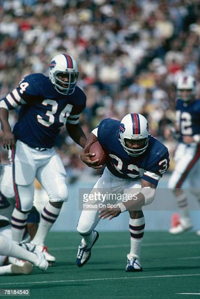 BUFFALO NY CIRCA 1970's Running back OJ Simpson of the Buffalo Bills carries the ball during a mid circa 1970's NFL game against the Denver Broncos...