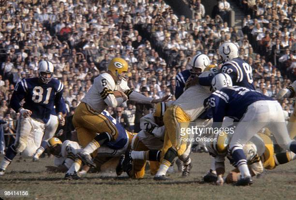 BALTIMORE MD CIRCA 1960's Running back Paul Hornung of the Green Bay Packers carries the ball against the Baltimore Colts circa mid 1960's during a...
