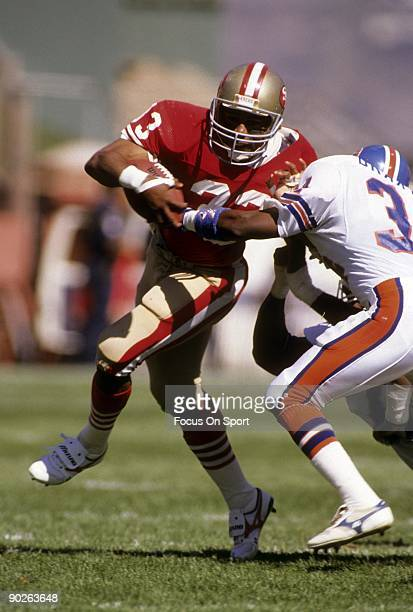 SAN FRANCISCO CIRCA 1980's Running Back Roger Craig of the San Francisco 49ers carries the ball trying to break free from a Denver Broncos tackler...
