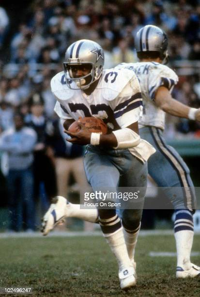 Running back Tony Dorsett of the Dallas Cowboys in action carries the ball circa late 1970's during an NFL game. Dorsett played for the Cowboys from...