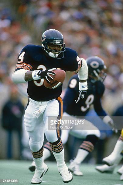 S: Running back Walter Payton of the Chicago Bears carries the ball during a circa 1980's NFL football game at Soldier Field in Chicago, Illinois....