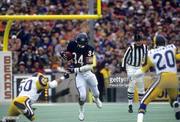 S: Running back Walter Payton of the Chicago Bears in action avoids the tackle of linebacker Jim Collins of the Los Angeles Rams circa mid 1980's...