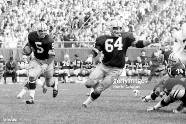 BAY WI 1960's Runningback Paul Hornung and Jerry Kramer of the Green Bay Packers run the Lombardi Sweep during a game in the 1960's against the St...