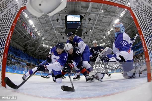 USA's Ryan Donato fights with Slovakia's Marek Daloga and Slovakia's Michal Cajkovsky for the puck as Slovakia's Jan Laco watches in the men's...