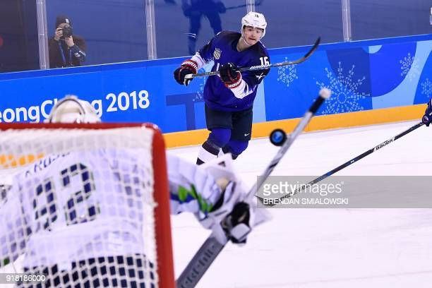 USA's Ryan Donato takes a shot during the final period of the men's preliminary round ice hockey match between the United States and Slovenia during...