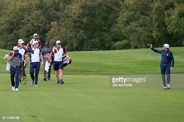 S Ryan Moore arrives at the fairway during a practice round ahead of the 41st Ryder Cup at Hazeltine National Golf Course in Chaska, Minnesota,...