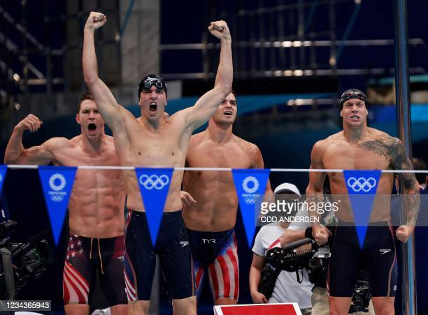 S Ryan Murphy, USA's Zach Apple, USA's Michael Andrew and USA's Caeleb Dressel celebrate winning to take gold in the final of the men's 4x100m medley...