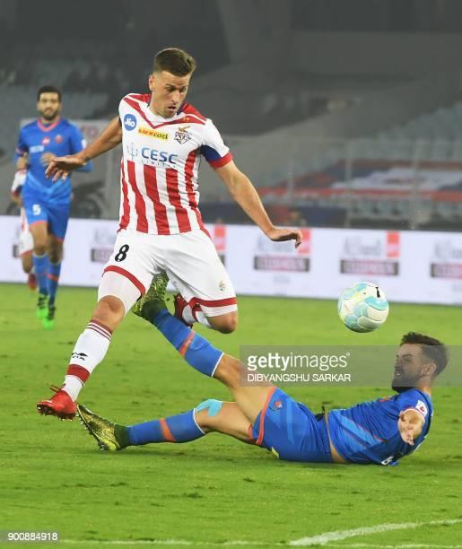 ATK's Ryan Taylor vies with FC Goa's Bruno Pinheiro during the Indian Super League football match between ATK and FC Goa at the Vivekananda Yuba...