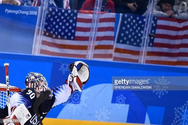 USA's Ryan Zapolski tries to catch the puck during the final period of the men's quarterfinals playoffs ice hockey match between the United States...