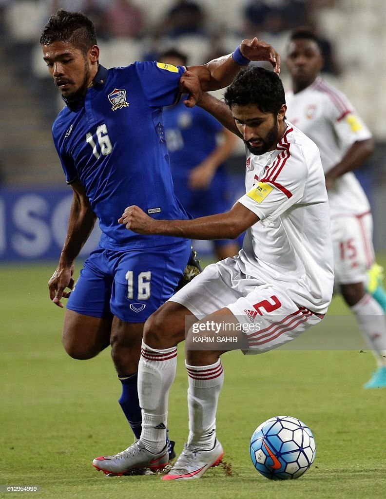 UAE's Salem Saleh (R) dribbles by Thailand's Pratum Chuthong during the 2018 FIFA World Cup Qualifiers match between United Arab Emirates and Thailand at the Mohammed Bin Zayed Stadium in Abu Dhabi on October 6, 2016. / AFP / KARIM