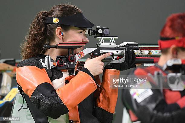 USA's Sarah Scherer competes in the women's 10m air rifle shooting final at the Rio 2016 Olympic Games at the Olympic Shooting Centre in Rio de...