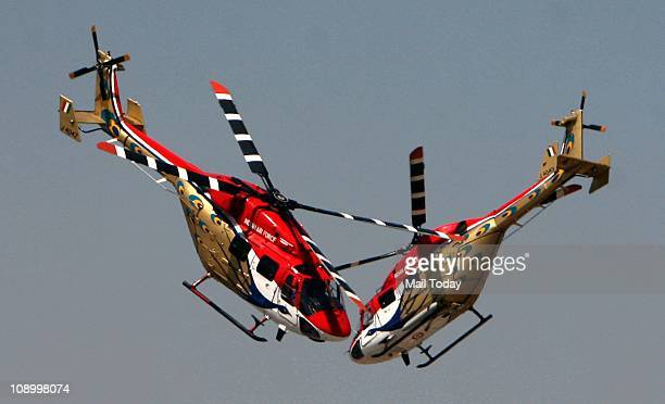 IAF's Sarang helicopters display their skills during the Aero India 2011 India's biggest air show at Yelahanka Air base in Bangalore on Thursday