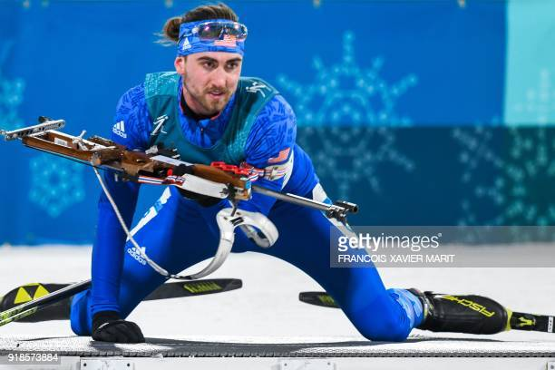 USA's Sean Doherty competes at the shooting range in the men's 20km individual biathlon event during the Pyeongchang 2018 Winter Olympic Games on...