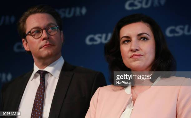 CSU's secretary general and designated minister of traffic Andreas Scheuer and CSU's vice chairwoman Dorothee Baer stand on the stage in Munich...
