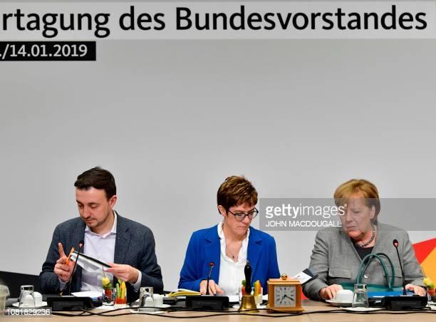 CDU's Secretary General Paul Ziemiak leader of the Christian Democratic Union Annegret KrampKarrenbauer and German Chancellor Angela Merkel wait at...