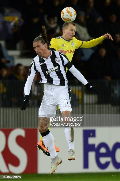PAOK's Serbian forward Aleksandar Prijovic and BATE Borisov's Belarus defender Denis Polyakov vie for the ball during the UEFA Europa League group L...