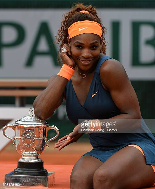 S Serena Williams poses with her trophy after defeating Russia's Maria Sharapova in the Women's Final of the French Tennis Open 2013 at Roland-Garros...