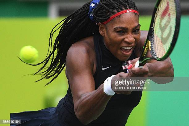 S Serena Williams returns the ball to Australia's Daria Gavrilova during their women's first round singles tennis match at the Olympic Tennis Centre...