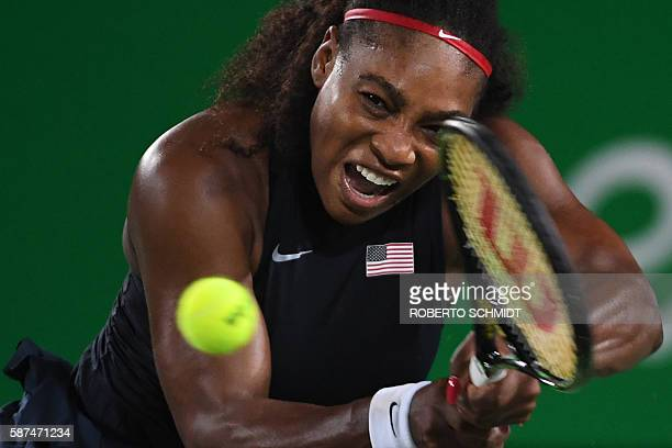 TOPSHOT USA's Serena Williams returns the ball to France's Alize Cornet during their women's second round singles tennis match at the Olympic Tennis...