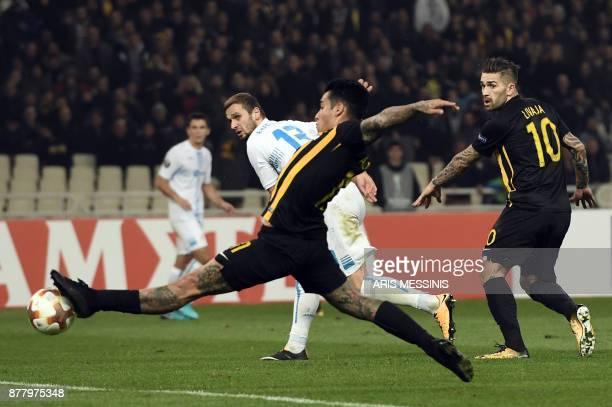 AEK's Sergio Araujo scores a goal as Rijeka's Dario Zuparic and AEK's Marko Livaja look on during the UEFA Europa League Group D football match...