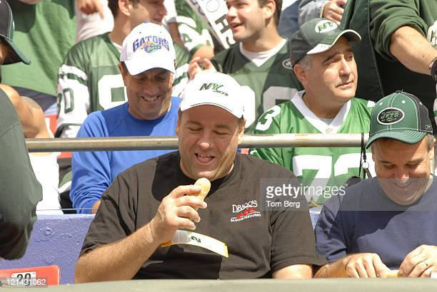 HBO's Series the Soprano's star James Gandolfini in the stands trying to enjoy a hotdog while photographers snap his photo before the start of the...