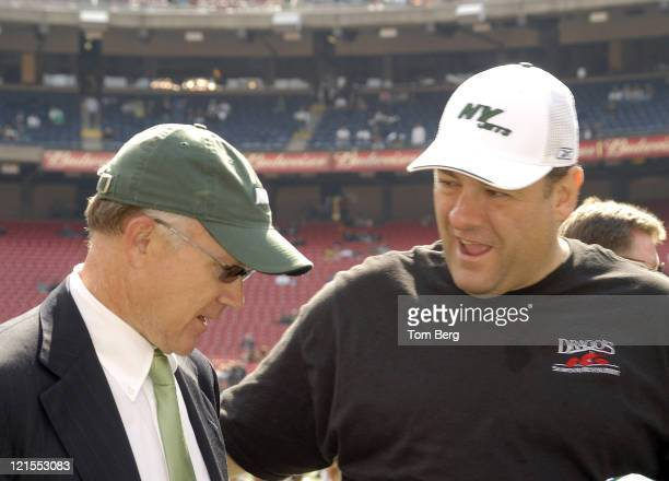 HBO's Series the Soprano's star James Gandolfini on the field talking to New York Jets owner Woody Johnson before the start of the Indianapolis Colts...