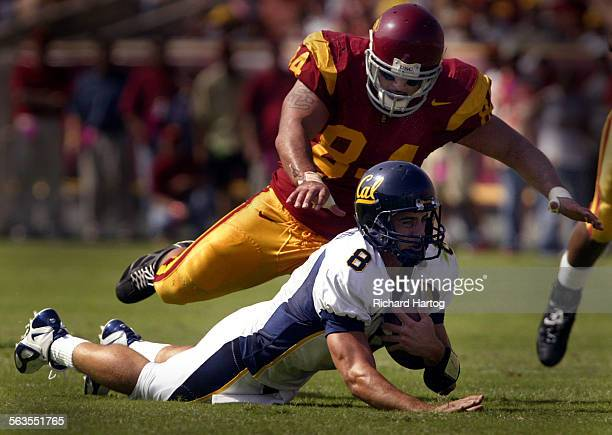 USC's Shaun Cody pounces on Cal quarterback Aaron Rodgers as Rodgers tries to pick up some yardage during first quarter football action of USC vs Cal...