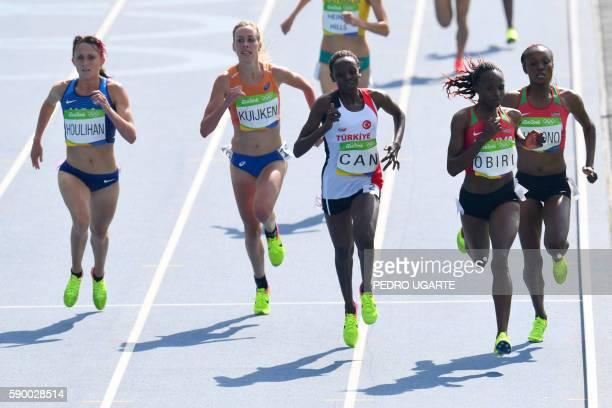 S Shelby Houlihan, Netherlands' Susan Kuijken, Turkey's Yasemin Can, Kenya's Helen Obiri and Kenya's Mercy Cherono compete in the Women's 5000m Round...