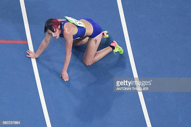 S Shelby Houlihan reacts after she competed in the Women's 5000m Final during the athletics event at the Rio 2016 Olympic Games at the Olympic...