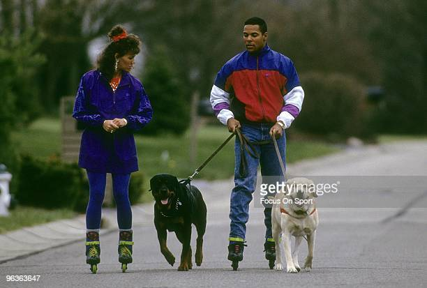 CINCINNATI OH CIRCA 1990's Shortstop Barry Larkin of the Cincinnati Reds and his wife Lisa out roller blading with their two dogs circa 1990's in...