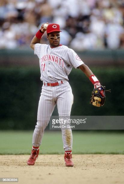 CHICAGO IL CIRCA 1990's Shortstop Barry Larkin of the Cincinnati Reds in action throws the ball around the infield during a circa early 1990's MLB...