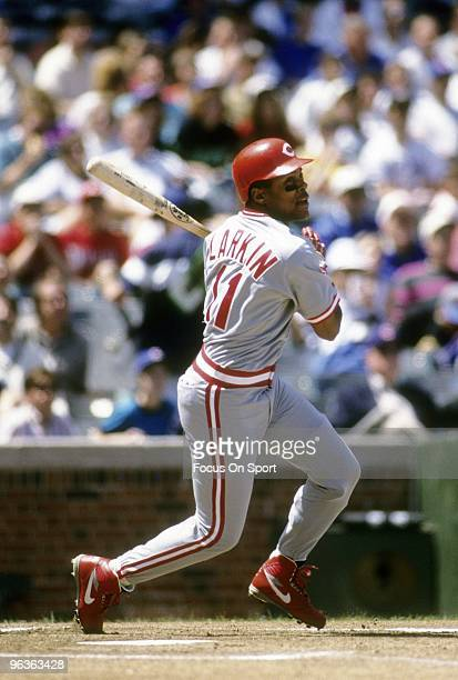 CHICAGO IL CIRCA 1990's Shortstop Barry Larkin of the Cincinnati Reds swings and watches the flight of his ball against the Chicago Cubs during a...