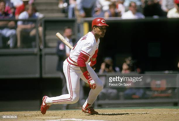 CINCINNATI OH CIRCA 1980's Shortstop Barry Larkin of the Cincinnati Reds swings and watches the flight of his ball during a MLB baseball game circa...