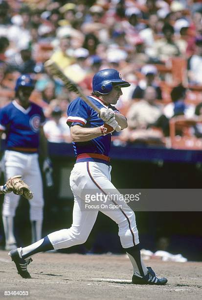CIRCA 1980's Shortstop Larry Bowa of the Chicago Cubs swings and watches the flight of his ball during a circa mid 1980's Major League Baseball game...