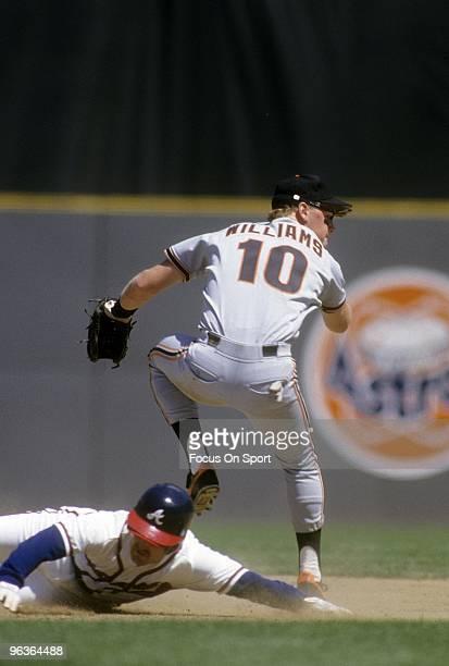 ATLANTA GA CIRCA 1980's Shortstop Matt Williams of the San Francisco Giants avoids the Atlanta Braves sliding runner to get his throw off from second...