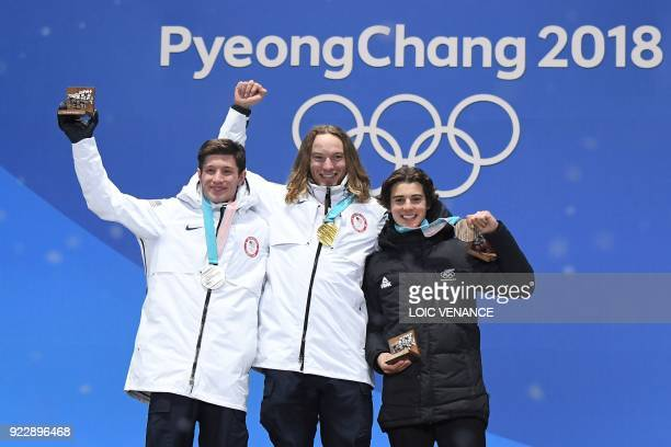 USA's silver medallist Alex Ferreira USA's gold medallist David Wise and New Zealand's bronze medallist Nico Porteous pose on the podium during the...