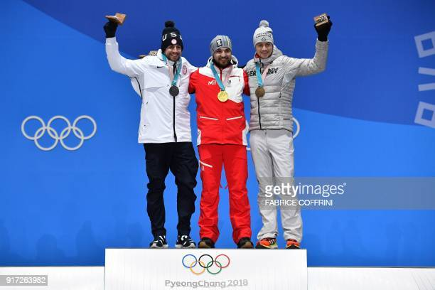 USA's silver medallist Chris Mazdzer Austria's gold medallist David Gleirscher and Germany's bronze medallist Johannes Ludwig pose on the podium...