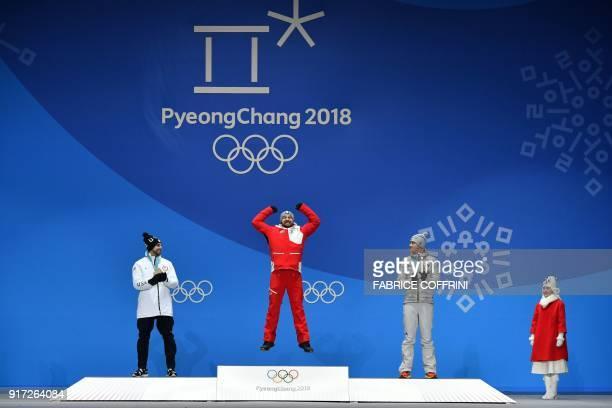 TOPSHOT USA's silver medallist Chris Mazdzer Austria's gold medallist David Gleirscher and Germany's bronze medallist Johannes Ludwig celebrate on...