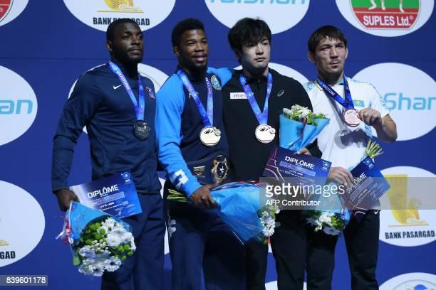 USA's silver medallist James Green Italy's gold medallist Frank Chamizo and bronze medallists Japan's Yuhi Fujinami and Georgia's Zurabi...