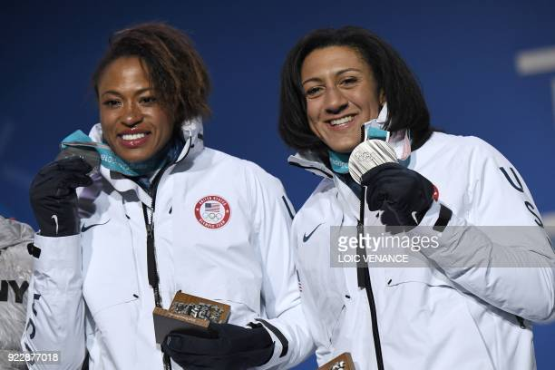USA's silver medallists Elena Meyers Taylor and Lauren Gibbs pose on the podium during the medal ceremony for the women's bobsleigh at the...