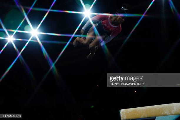 USA's Simone Biles performs on the beam during the women's team final at the FIG Artistic Gymnastics World Championships at the...