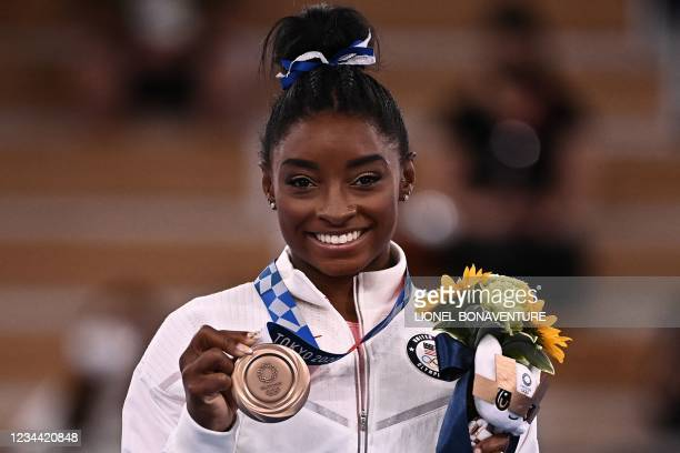 S Simone Biles poses with her bronze medal during the podium ceremony of the artistic gymnastics women's balance beam of the Tokyo 2020 Olympic Games...