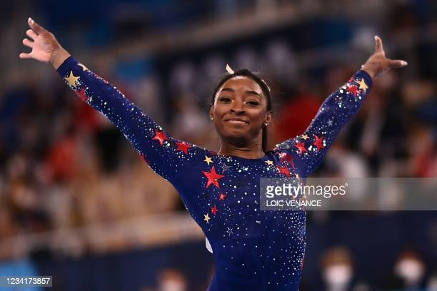 S Simone Biles reacts after competing in the artistic gymnastics balance beam event of the women's qualification during the Tokyo 2020 Olympic Games...