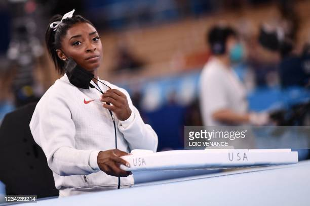 S Simone Biles waits for the final results of the artistic gymnastics women's team final during the Tokyo 2020 Olympic Games at the Ariake Gymnastics...