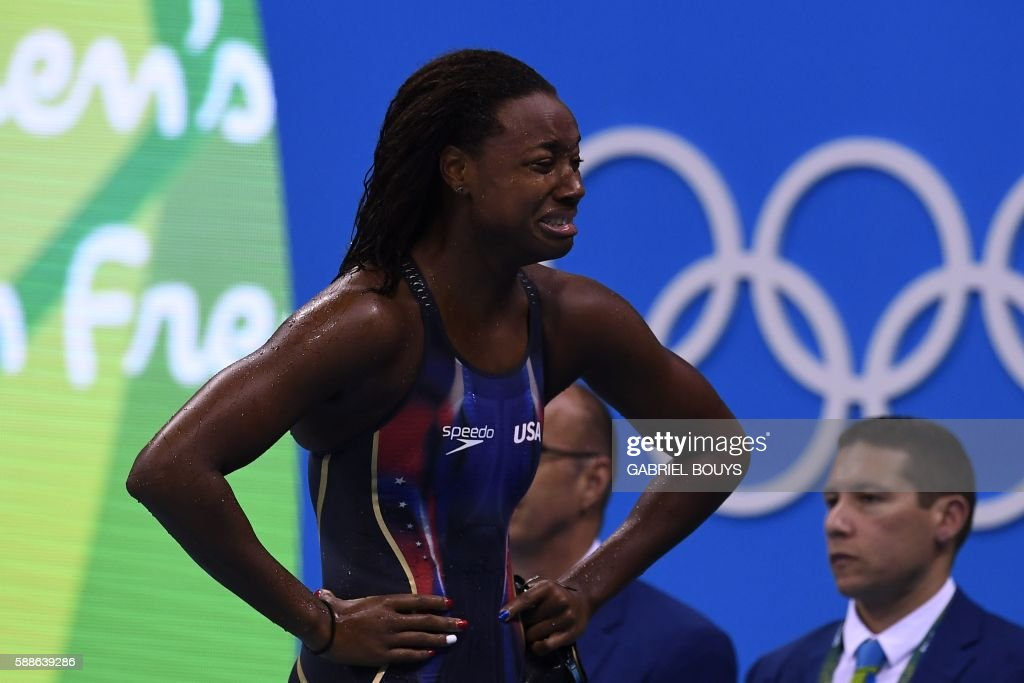 TOPSHOT - USA's Simone Manuel cries after she won the Women's 100m Freestyle Final during the swimming event at the Rio 2016 Olympic Games at the Olympic Aquatics Stadium in Rio de Janeiro on August 11, 2016. /