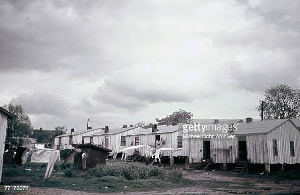 MID 1930's Slaves hang out their laundry outside their shacks during a recreation of pre Civil War life on a plantation circa mid 1930's in the deep...