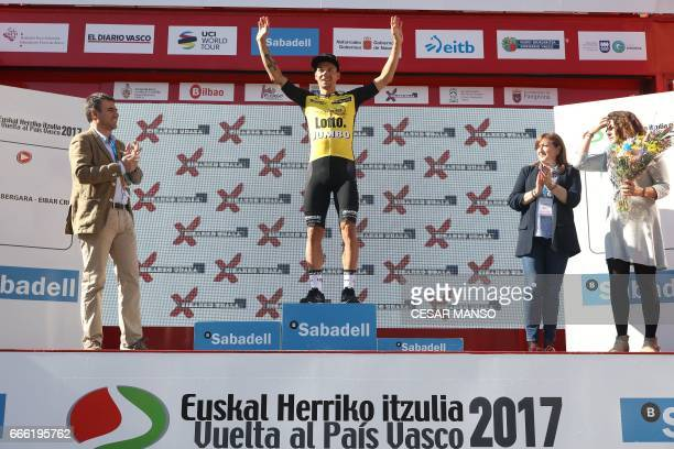 TLJ's Slovenian cyclist Primoz Roglic celebrates on the podiumn winning the last stage of the 2017 Tour of the Basque Country a 277km individual time...